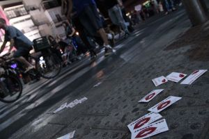 Stripper/prostitute flier cards litter the streets of Tel Aviv at night
