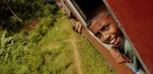 """Just relax and enjoy the ride"" advises Sri Lankan train kid"