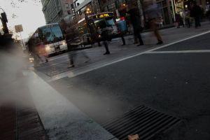 slow shutter speed, blurred people crossing the street