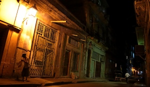 Havana sidestreet at night with woman