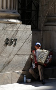 It's almost certain he'll make more with an accordion on the tourist street than he would as a surgeon here.