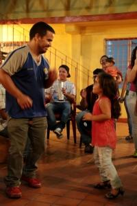 Alvaro dancing with his daughter