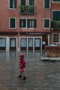 Child in the rain, Venice