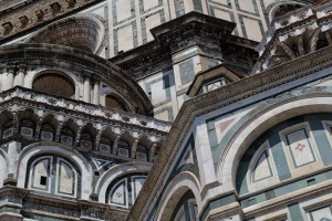 Outside Florence's Duomo, with its elaborate angles and characteristic coloration.