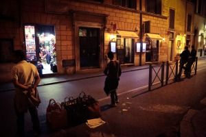 Purse vendors and businessmen in Rome