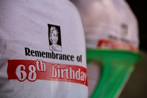 I stopped by Aung Sun Suu Kyi's birthday party, which was fantastic. But why were the shirts in English? (About 100 languages are spoken in Myanmar. Oh.)