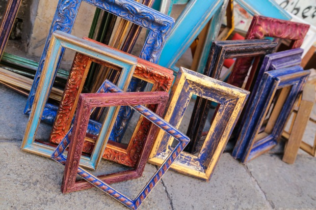 Picture frames on a Venetian sidewalk
